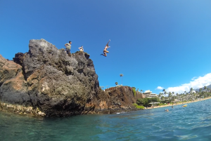 jumping off the rocks in Kaanapali, Maui